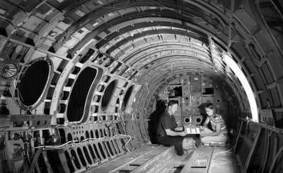 Engineers Reviewing Repair Data Inside Aircraft Fuselage