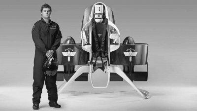 Pilot Standing Next to Martin Jetpack